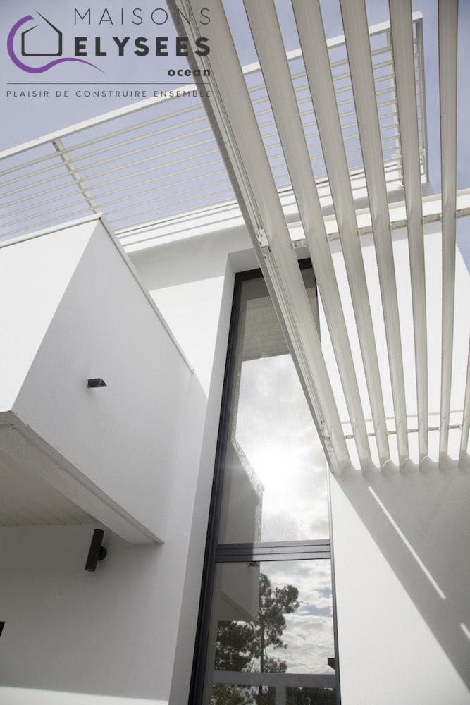Maison contemporaine avec mur rideau en Charente Maritime