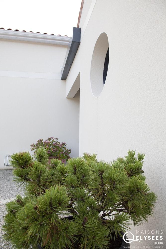 Maison avec toiture terrasse et toiture traditionnelle 10