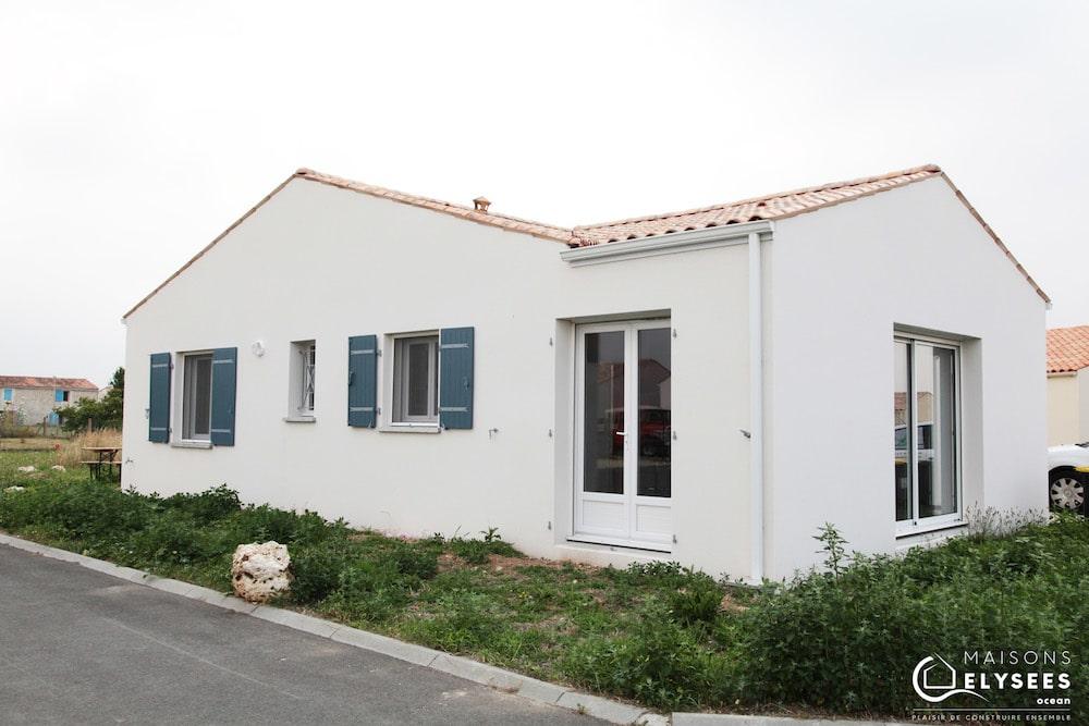 Maison de plain pied avec plan en L low cost 4
